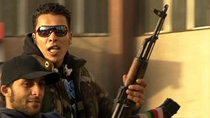 A man holding a gun in Benghazi