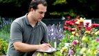 PhD student Mihail Garbuzov collecting data in the experimental garden (c) LASI