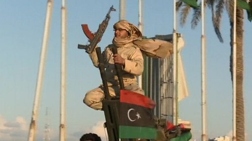 Libyan fighter celebrating toppling Gaddafi
