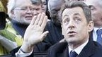 France's President Nicolas Sarkozy waves to well-wishers as he campaigns for his re-election