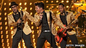 Bruno Mars (centre) and his band