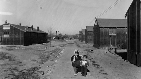 Two young children walking through the Minidoka Internment Camp in Idaho, one of the camps where Mary spent time. Photo courtesy of Wing Luke Museum
