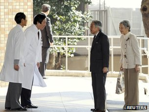 Emperor Akihito and Empress Michiko are greeted by doctors at the University of Tokyo hospital on 17 February 2012