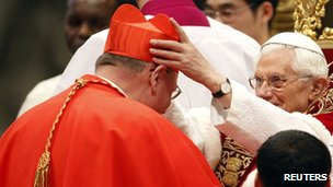 Pope Benedict XVI places a biretta on new Cardinal Timothy Dolan of the US at the consistory in Rome on 18 February 2012