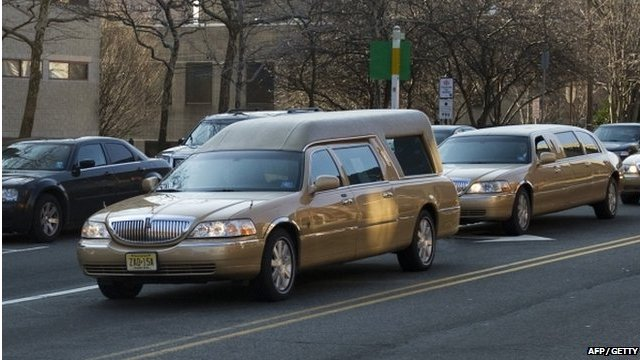 The gold hearse containing Whitney Houston&#039;s coffin