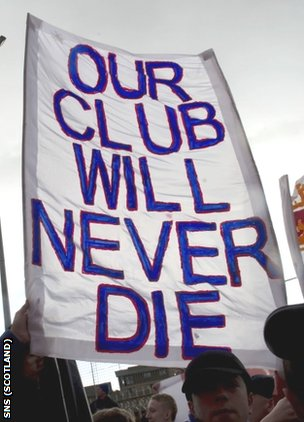 Rangers fans display a banner