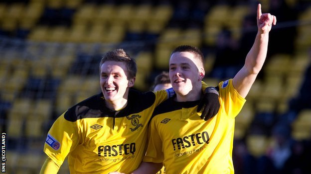 Bobby Barr (left) celebrates with Livingston's hat-trick scorer Marc McNulty