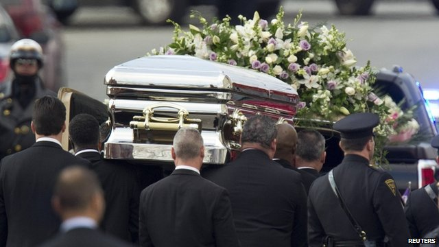 Coffin leaves the church