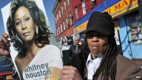Fan holds picture of Whitney Houston
