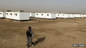 An Iraqi soldier stands guard in the former US military Camp Liberty outside Baghdad which will be the new temporary home for the People&#039;s Mujahideen Organisation of Iran (PMOI) exiles