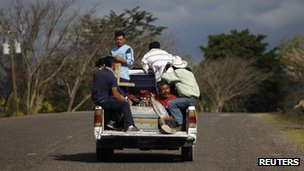 The coffin of one of the victims of a prison fire in Honduras is transported to a cemetery