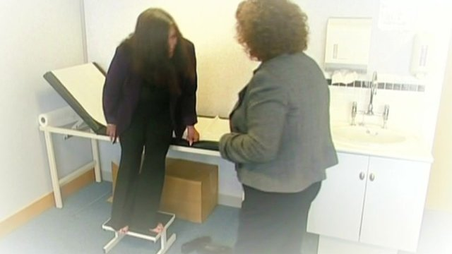 Woman receives disability assessment.