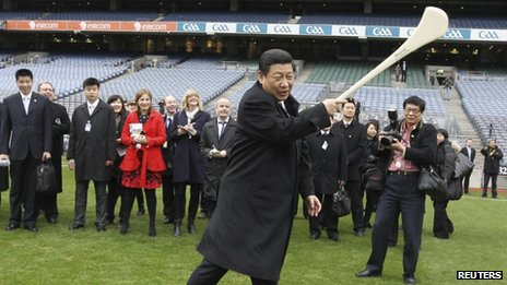 Chinese Vice-President Xi Jinping swings a hurling stick in Croke Park, Dublin, 19 February