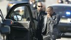 Bobby Brown (R)  leaves the funeral service of ex-wife pop singer Whitney Houston at the New Hope Baptist Church in Newark, New Jersey February 18, 2012