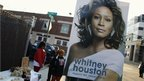 A poster of the late singer Whitney Houston hangs on a sign post near the New Hope Baptist Church before her funeral service in Newark, New Jersey February 18, 2012