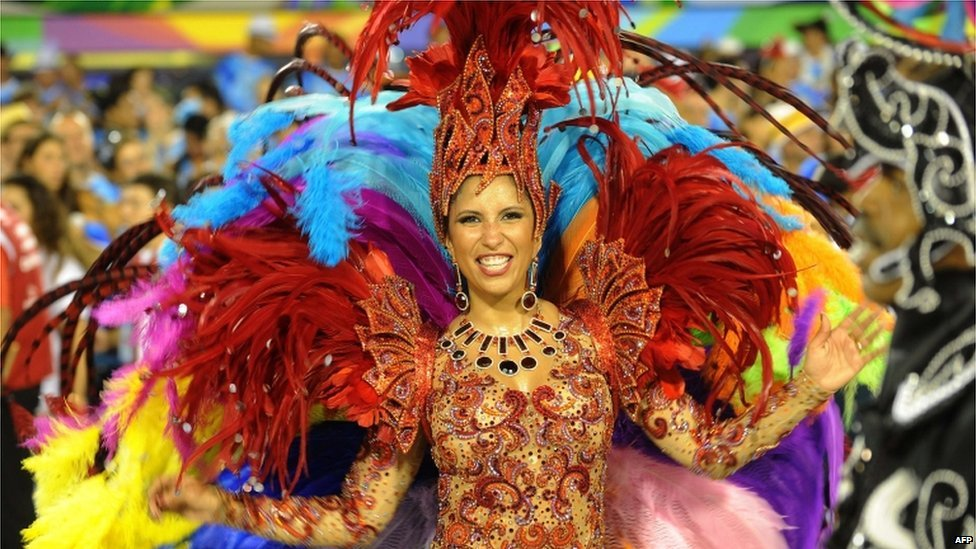 A reveller of Renascer samba school dances during the first night of the carnival parade at