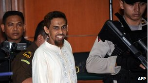 Bali bombing suspect Umar Patek enters a court room in Jakarta on 20 February, 2012