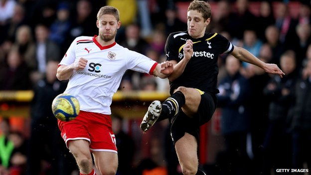 Dawson of Spurs and May of Stevenage in tackle