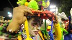 A reveller from the Renascer samba school adjusts her hat before the parade