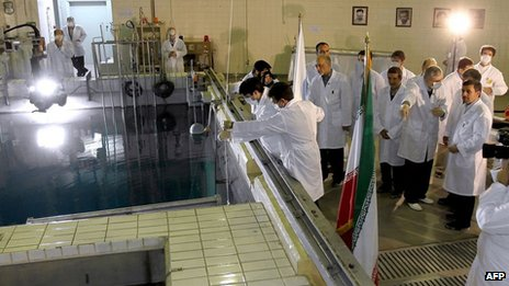 Mahmoud Ahmadinejad (R) during a tour of Tehran&#039;s research reactor (February 15, 2012)