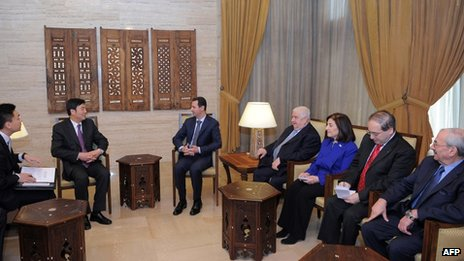Handout picture released by Syrian official media shows President Bashar al-Assad (C-R) meeting with Chinese Vice Foreign Minister Zhai Jun (C-L) in Damascus (February 18 , 2012)