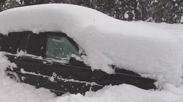 Trapped in snow covered car