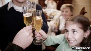 Child joining in a family toast