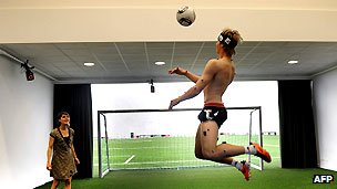 An athlete with sensors stuck to his body prepares to play football in the new Ajax miCoach Performance Centre in Amsterdam