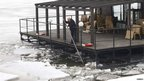Man clearing ice from floating restaurant on the River Danube, Belgrade (20 February 2012)