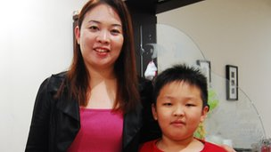 Aw Yee Han and his mother