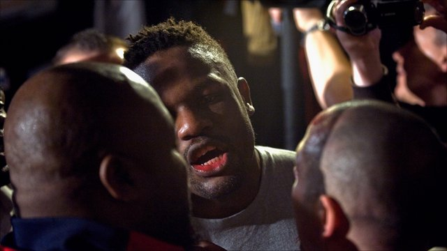 Chisora speaks to Adam Booth following the brawl with Haye