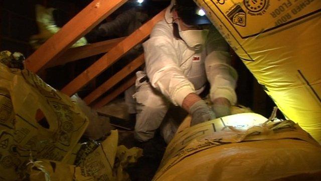 A workman in a loft
