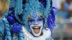 A woman dressed in blue taking part in the first night of the Rio Carnival