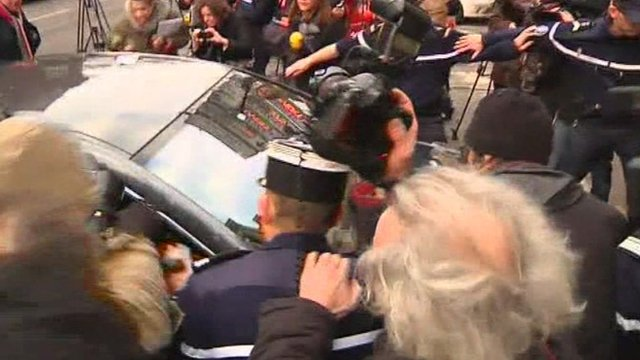 The car carrying Dominique Strauss-Kahn arrives at a police station in Lille