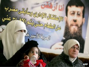 The wife, daughter and mother of Khader Adnan site in the family&#039;s home in the West Bank village of Arrabeh (21 February 2012)