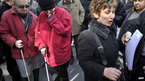 A blind woman chants slogans written in Braille during a demonstration in Athens against salaries and pensions cuts, 21 February