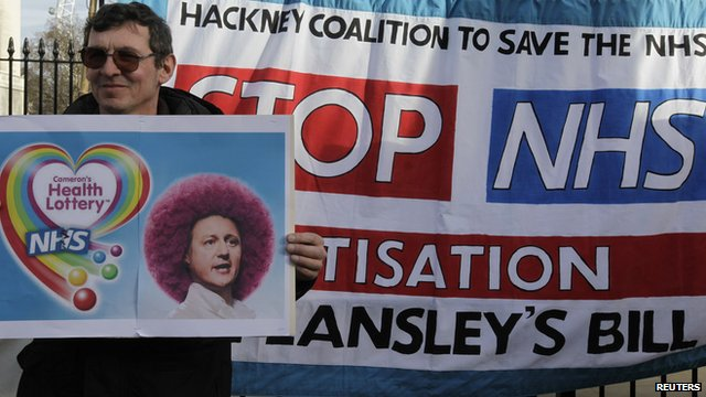 A protestor holds a placard outside Downing Street