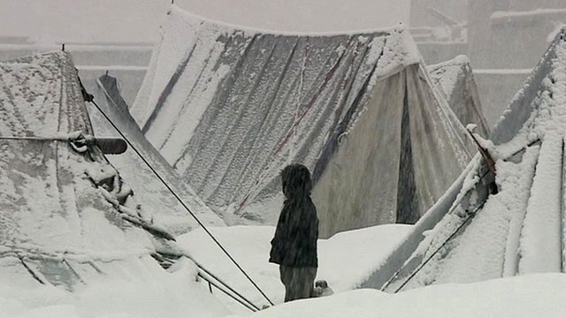 Child among tents in snow
