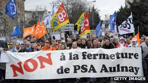 Peugeot Citroen workers and union members demonstrate on February 18, 2012