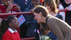 The Duchess of Cambridge talks to a pupil at Rose Hill Primary School
