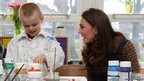 The Duchess of Cambridge talks to a pupil during an Art Room lesson at Rose Hill Primary School in Oxford