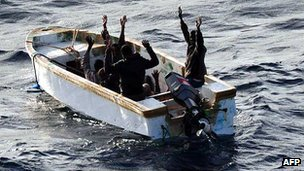 Suspected pirates surrendering to Spanish naval vessel