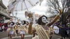 Women dance in baby doll outfits as part of the Zulu Mardi Gras parade in New Orleans, Louisiana 21 February 2012