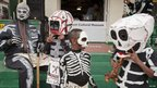 Members of the North Side Skull and Bone gang put on their masks for Mardi Gras in New Orleans, Louisiana 21 February 2012