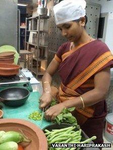 Jyoti cutting vegetables in the Gateway Hotel, Bangalore, India