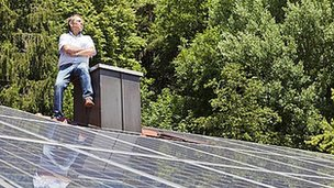 Man on solar roof