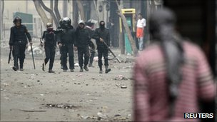 Protester hides from riot police on street close to Cairo's interior ministry on 6 Feb