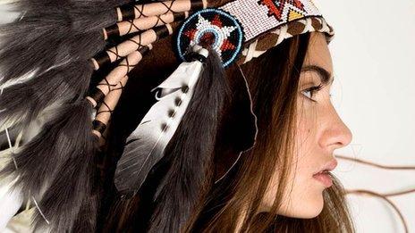 Model wears a head dress