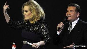 Adele with host James Corden at the Brit Awards