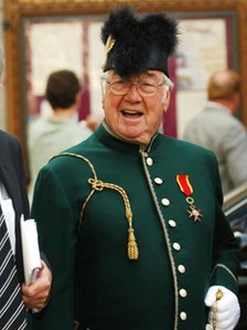Frank Carson in the uniform of a Knight of St Gregory at the funeral of Lord Fitt